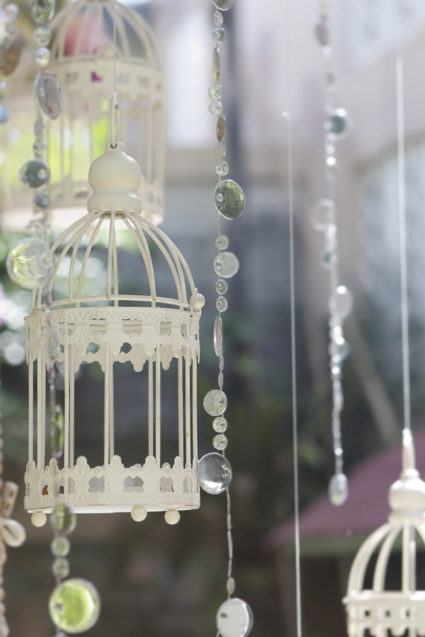 vintage wedding decorative birdcage with flowers on natural background
